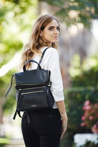 Як носити рюкзаки